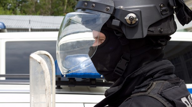 Cop-in-riot-gear-via-Shutterstock-615x345