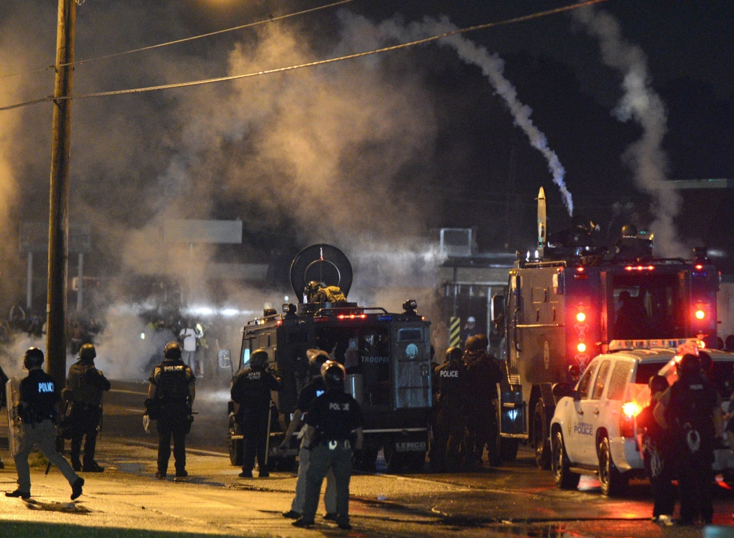 Image: Curfew set after violent protests flare amid over Michael Brown shooting